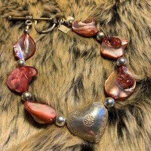 Jewelry - Amethyst shell bracelet.